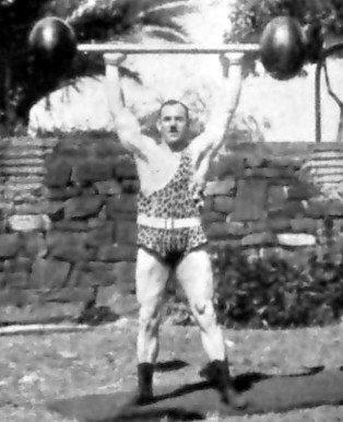 old school vintage weightlifting dumbells press overhead