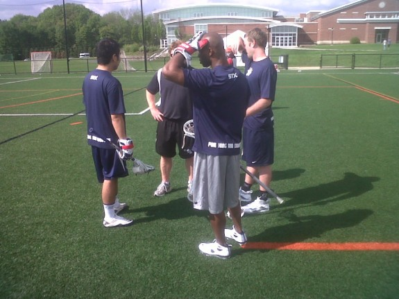 Payu, Chazz, Sean Lindsay and the Suffield Coach have a little pow-wow.
