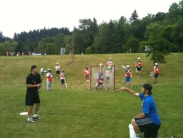Coach White and Coach Galloway working with the goalies