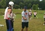RP helping out a camper understand the drill.