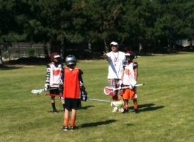 Coach Cost coaching during the Numbers drill at Rhino Lacrosse Camp