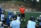 Coach Cost coaching it up.