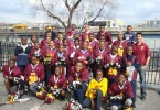Head Coach Simon Cataldo (far right) with a portion of the Frederick Douglass Academy Middle School Lacrosse squad.