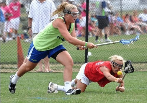 A Tex-Islander (Butz) from Mary Washington fighting hard for the ball