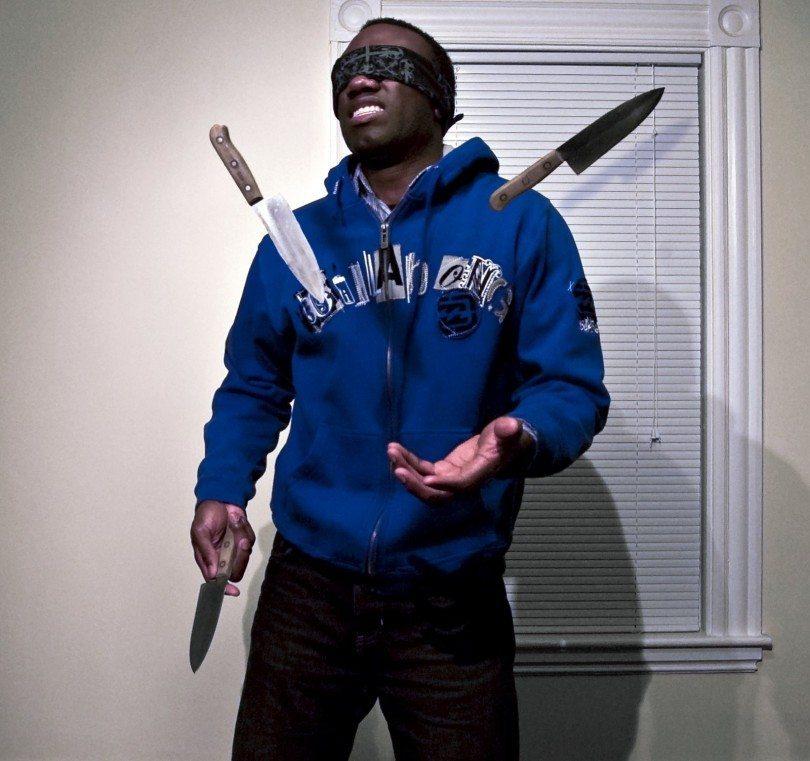 Blindfold man juggling knives Blind Item