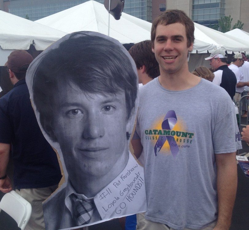 Brown lacrosse player Sam Ford supports Loyola's Patrick Fanshaw