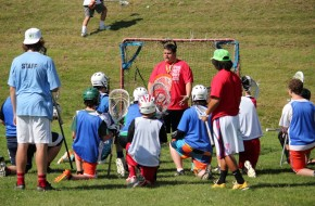Coach Benny G working hard with the goalies.