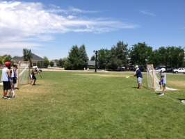 Coach Cost and Coach Mikey teaching these studs a new goalies drill.