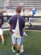Coach Kaz getting creative in carrying his teams balls.