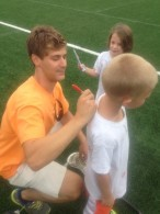 Former Brown goalie Matt Chriss signing autographs.
