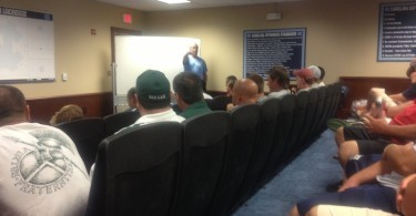 Coaches social in the UNC film room.