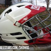 """This is my son Quinn's lid. Quinn plays with the Fulton Youth Lacrosse program 3rd-4th graders. Last year, the photographer didn't have to search too hard for a helmet for player photos when he saw #11's CPX-R white/red with the green Mohawk."""