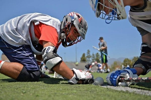 Face-off Factory lacrosse facing off camp