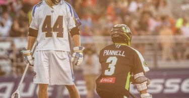 Brett Schmidt and Rob Pannell chat during a pause in the action during a Long Island Lizards 14-12 win at Hofstra Stadium in Hempstead NY