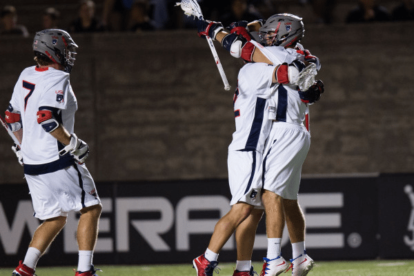 Team USA celebrates Rob Pannell's game winning goal with a few ticks left on the clock in their 10-9 win for Team USA at Harvard Stadium in Cambridge MA on June 26th 2014.