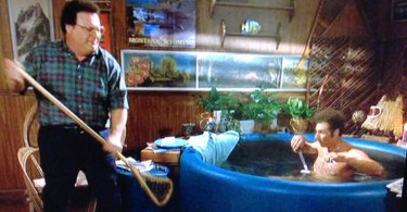 spotted wooden lacrosse stick in seinfold hot tub