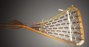 old wooden goalie stick